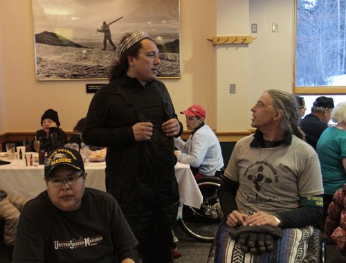 Two men, one of them disabled and in a wheelchair, conversing in a skier's diner at Taos Ski Valley.