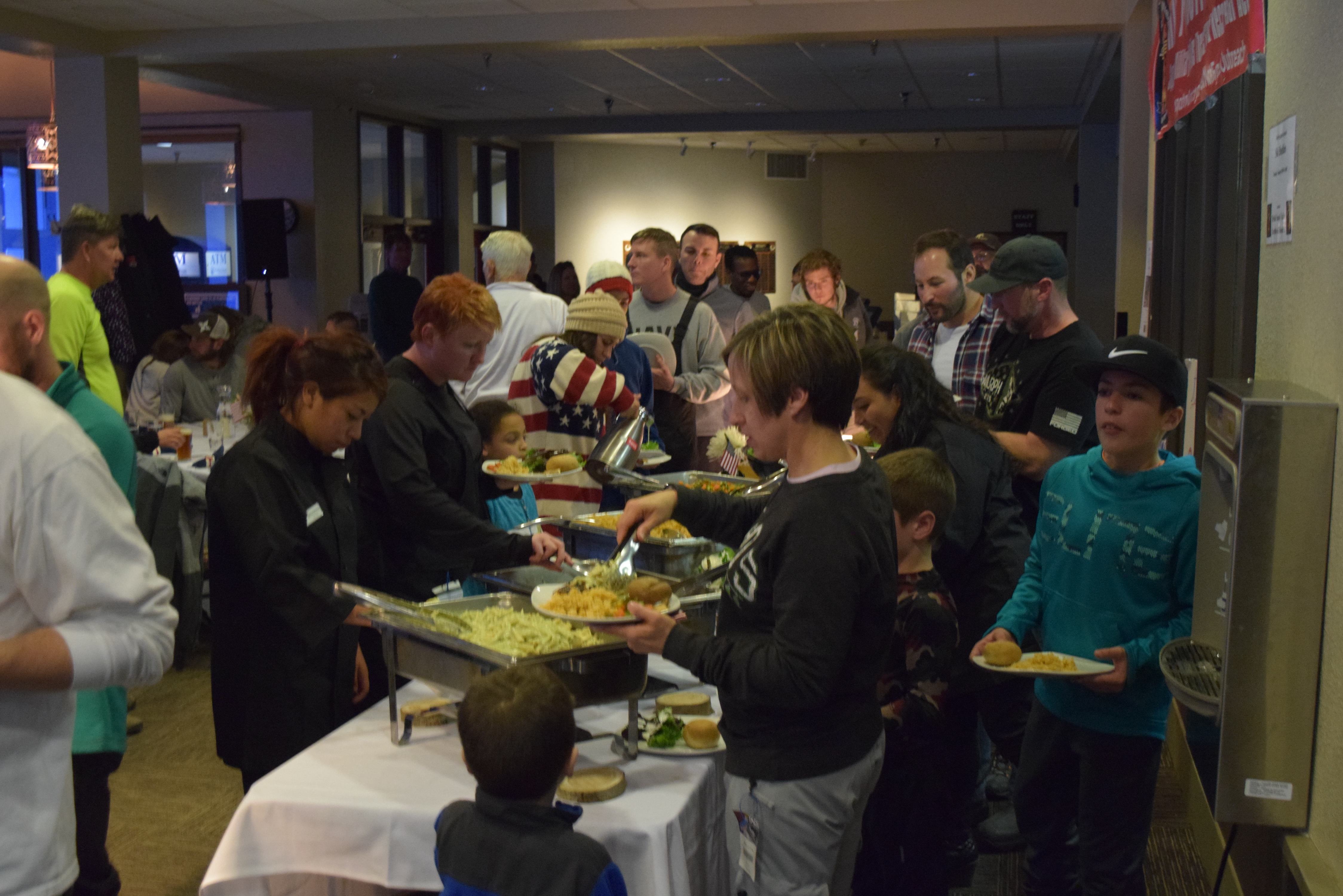 Busy dinner buffet at skier's diner in the evening
